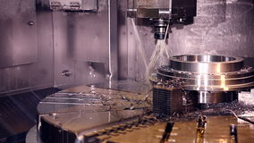 CNC milling machine makes steel part on a industrial factory stock video