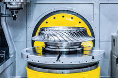 The CNC milling machine processes the turbine wheel. Royalty Free Stock Images