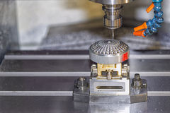 CNC Milling operation on the sample work pieces. The CNC milling machine while cutting the sample work piece Stock Images