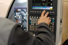 CNC operator programming lathe machine. Selective focus Stock Photos
