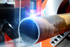 CNC plasma cutting machine for metal pipes. CNC plasma cutting machine. Plasma cutter cuts a metal pipe Royalty Free Stock Image