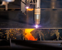 CNC Plasma torch cutting steelplate with red sparks Stock Photo