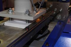 Cnc press feeder detail royalty free stock photography