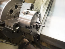 Cnc turning. Operator machining high precision mold part by cnc lathe Stock Photos