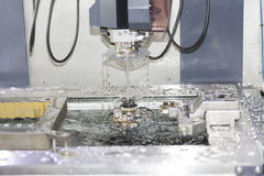 CNC wire cut machine cutting mold parts Stock Photography