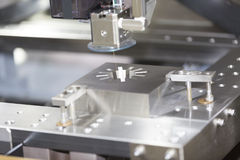 CNC wire cut machine cutting mold parts Royalty Free Stock Images