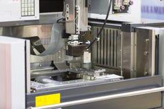 CNC wire cut machine cutting mold parts Stock Photo