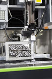 CNC wire cut machine cutting mold parts Royalty Free Stock Photo