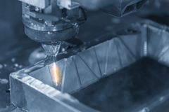 The CNC wire-edm machine cutting the metal plate royalty free stock image