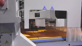 CNC woodworking machine. Cnc machine drills holes in the wooden shield. Cnc machine at technology exhibition