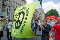 CND Banner, protest march. LONDON, ENGLAND - JUNE 21, 2014:  The General Secretary of Campaign for Nuclear Disarmament, Kate Hudson, holding up one side of the Stock Photos