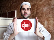 CNET media website logo. Logo of CNET media website on samsung tablet holded by arab muslim man. CNET is an American media website that publishes reviews, news royalty free stock images