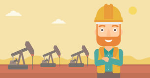 Cnfident oil worker. A hipster man in helmet standing with crossed arms on an oil derrick background vector flat design illustration. Horizontal layout Royalty Free Stock Photography