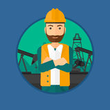Cnfident oil worker. A hipster oil worker in uniform and helmet standing with crossed arms on pump jack background. Vector flat design illustration in the Royalty Free Stock Photos