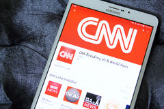 Cnn news channel app logo. Downloading cnn news channel application from google play store on samsung tab s2 royalty free stock photos
