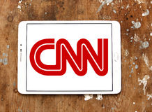 Cnn news channel logo. Logo of Cnn news channel on samsung tablet on wooden background Royalty Free Stock Image