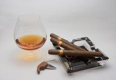 Coñac y cigarro Fotografía de archivo libre de regalías