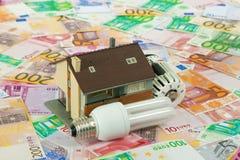 Coûts économiseurs d'énergie Images stock