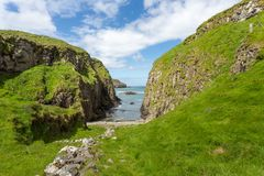 Co. Antrim`s Rolling Hills. Co. Antrim, N. Ireland/United Kingdom - June 2, 2015: On the north coast of northern Ireland in County Antrim the hills roll right royalty free stock photography