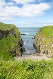 Co. Antrim`s Rolling Hills. Co. Antrim, N. Ireland/United Kingdom - June 2, 2015: On the north coast of northern Ireland in County Antrim the North Sea sparkles stock image
