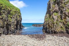 Co. Antrim`s Rolling Hills. Co. Antrim, N. Ireland/United Kingdom - June 2, 2015: On the north coast of northern Ireland in County Antrim the North Sea sparkles royalty free stock photo