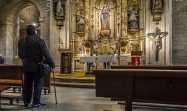 Co-cathedral of Santa Maria de la Redonda of Logroño, Spain. Logroño, Spain - April 10, 2016. Men praying in front of altar of Nuestra Señora de los royalty free stock image