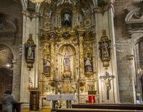 Co-cathedral of Santa Maria de la Redonda of Logroño, Spain. Logroño, Spain - April 10, 2016. Woman praying in front of altar of Nuestra Señora de los royalty free stock photo
