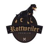Cão de Rottweiler em um crachá Imagem de Stock Royalty Free