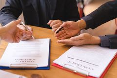 Co-investment business signing contract agreement after successful deal. royalty free stock photo