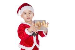 Co jest w Bożenarodzeniowym pudełku? Dziecko z Bożenarodzeniowym prezentem Obrazy Royalty Free