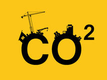 Co2 pollution illustrated in text with city polluction sillhouette Royalty Free Stock Images