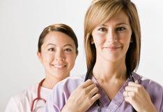 co-sjuksköterskan skurar slitage arbetare Arkivfoto