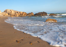 Co Thach Rock beach with wave in the sunlight morning Stock Photo