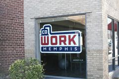 Co Work of Memphis. Cowork Memphis is a collaborative community of like-minded professionals that is part support system, part educational network, and part Royalty Free Stock Image