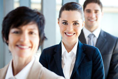 Co-workers. Pretty businesswoman and co-workers portrait Stock Images