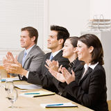 Co-workers applauding in meeting Royalty Free Stock Photo
