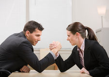 Co-workers arm wrestling for dominance Stock Photos