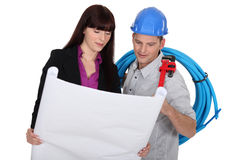 Co-workers with blueprints Stock Images
