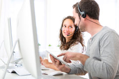 Co-workers on a call center having fun Royalty Free Stock Image