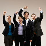 Co-workers cheering and celebrating royalty free stock photos