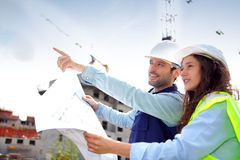 Co-workers on a construction site Stock Photography