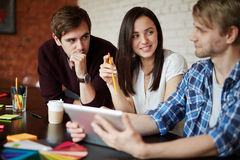 Co-workers consulting. Creative employees discussing their ideas and planning work Royalty Free Stock Photography