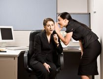 Co-workers gossiping Stock Photography