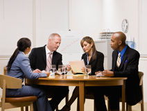Co-workers having meeting in conference room Stock Images
