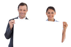 Co workers holding a blank copy space Royalty Free Stock Images