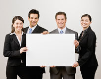 Co-workers holding blank paper Stock Photography