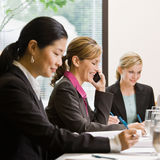 Co-workers meeting at table in conference room Royalty Free Stock Photos