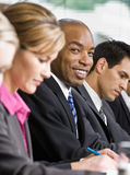 Co-workers meeting at table in conference room Royalty Free Stock Images