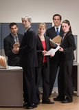 Co-workers meeting and working in cubicle Royalty Free Stock Photography