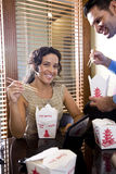 Co-workers in office eating Chinese takeout food Stock Photography